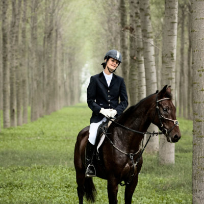 Field Horsewoman Waiting in a Poplar Grove