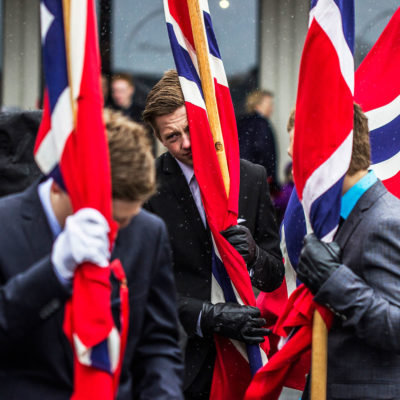 Young Standard Bearers Defying the Bad Weather in Svolvær, Lofoten