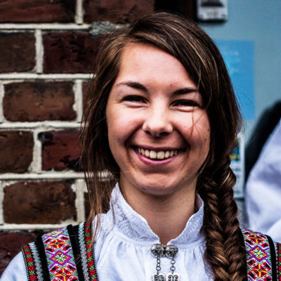 Young Norwegian Woman Wearing the Traditional Costume on the Bryggen Dock in Bergen