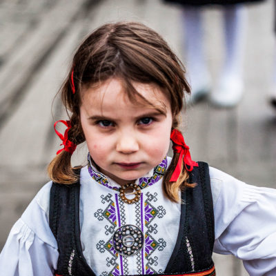 Norwegian Child Wearing the Traditional Costume on the Bryggen Dock in Bergen