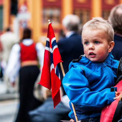 Child in the Arms of his Mother Attending the Festivities for the Constitution Day in the Marketplace of Bergen