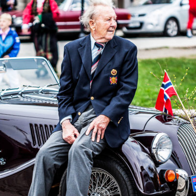 Old Norwegian Attends the Celebratory Parades along the Bryggen Dock