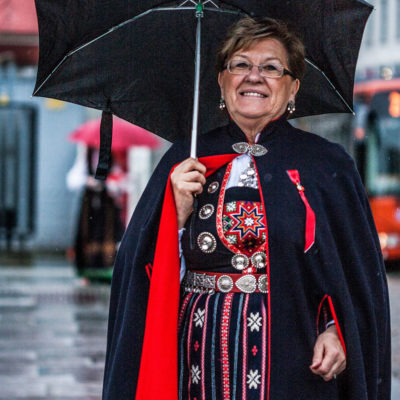 Woman Wearing the Traditional Bunad Lets Herself be Photographed near the Marketplace in Bergen