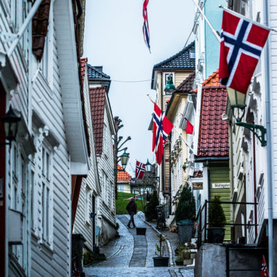 Norwegian Flags Waving from the Front of the Wood Houses in the Quarter of Nordnes