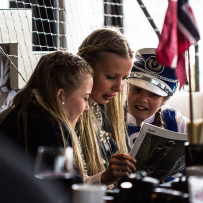 Children Reading a Magazine in a Bar of Svolvær, on the Lofoten Islands