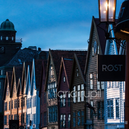 Painted Fronts and Sharp Roofs of Houses in Bryggen at the Sunset