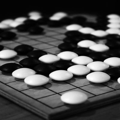 "White and black ""Stones"" compete for the supremacy over a space delimited by the surface of the goban. Go is an ancient Chinese strategy game. It is played a lot in Japan, acquiring its nationality, where it is considered a training for the power of self-control and order."