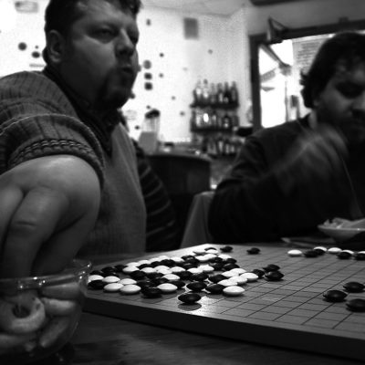 "Every Tuesday evening, at the ""Al Tempio d'Oro"" trattoria in Via delle Leghe, Milan, a group of enthusiasts from different origins challenge each other in exciting battles of ""stones""."